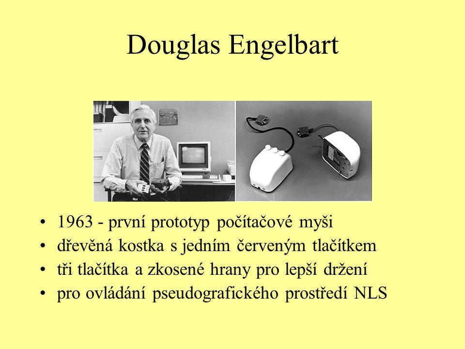Douglas Engelbart 1963 - první prototyp počítačové myši dřevěná kostka s jedním červeným tlačítkem tři tlačítka a zkosené hrany pro lepší držení pro o
