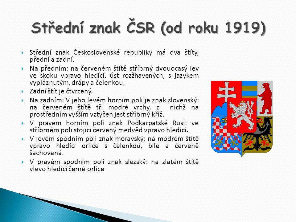  Střední znak Československé republiky má dva štíty, přední a zadní.  Na předním: na červeném štítě stříbrný dvouocasý lev ve skoku vpravo hledící,