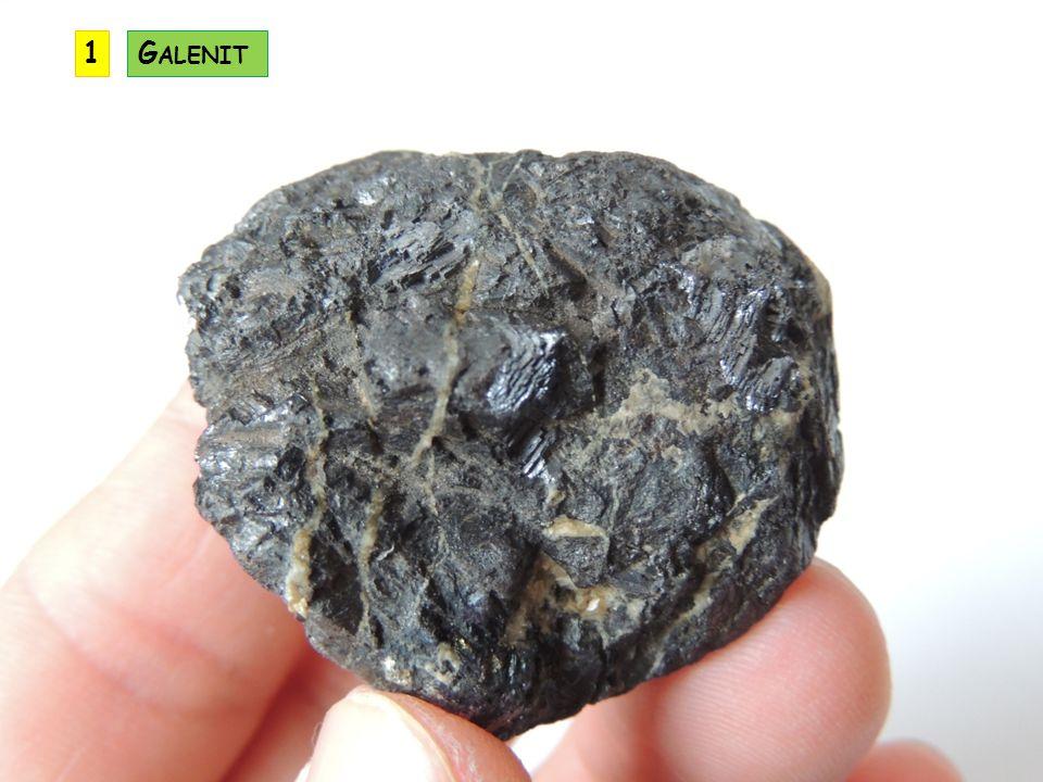 vytváří krásné krychle, často rýhované někdy vytváří srůstová dvojčata zvaná železný kříž ve vlhkém prostředí uvolňuje kyselinu sírovou a mění se na červenohnědý limonit pyritový prášek hoří namodralým plamenem a uvolňuje se při tom jedovatý oxid siřičitý jedná se běžný minerál – je v hydrotermálních žilách, mramorech, uhlí, sedimentech P YRIT (F E S 2 ) KRYSTALOVÁ SOUSTAVA: krychlová ŠTĚPNOST: chybí TVRDOST: 6,5 LOM: lasturnatý HUSTOTA: 5 VRYP: černý BARVA: mosazně žlutá LESK: kovový