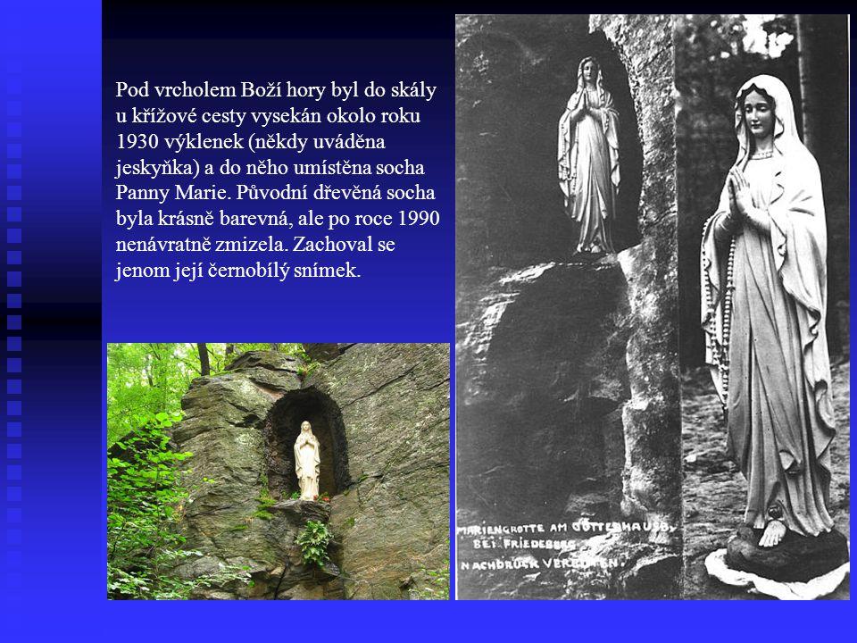 Pod vrcholem Boží hory byl do skály u křížové cesty vysekán okolo roku 1930 výklenek (někdy uváděna jeskyňka) a do něho umístěna socha Panny Marie.